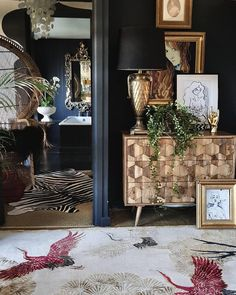 'Cranes in Trees' designer rug styled beautifully in Kate Learmonth's bedroom. …