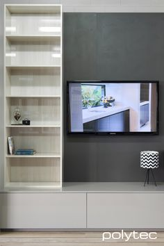 Polytec - Shelving in CREATEC Bleached Walnut. Media unit in CREATEC Stone Grey. Wall panel in imi-beton Board Smooth Anthracite.