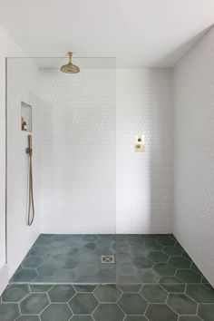 bathroom White hexagonal wall tiles from Grestec echo the shape of the large-scale cement floor tiles in forest green from Terrazzo Tiles. The brass shower fittings are from Bert & May. Hexagon Wall Tiles, Hexagon Tile Bathroom Floor, Cement Tiles Bathroom, Shower Floor Tile, Shower Walls, Bathroom Faucets, Bert And May Tiles, Tiled Hallway, Shower Fittings