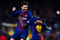 Lionel Messi of FC Barcelona celebrates with his teammate Ousmane Dembele after scoring his team's third goal during the La Liga match between Barcelona and Girona at Camp Nou on February 24, 2018 in Barcelona.