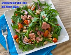 Recipe for a nutrient dense arugula salad with tuna, white beans, tomatoes and onions. Packed with vitamins K, A, and C. A great option for a workday lunch