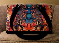 Art and Poetry Mid tote!   This tote is big enough to carry a bottle of wine!  It has a bright red lining and seven inside pockets to keep all you stuff organized!  It also has feet for protection.  $175.00
