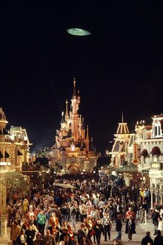#Disneyland Paris. Opening night of the park on April 12th 1992. A crowded Main Street and a view of the Sleeping Beauty Castle at night dark #DLP #DLRP #Disney 'Le Château de la Belle au Bois Dormant'