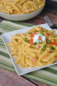 Chicken Enchilada Pasta... VERY good and will make again! I used one full box of Penne pasta, it fed 4 adults, 2 kids, and had some leftover!