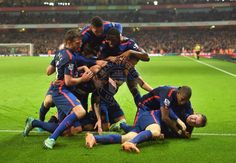 Rooney is dog-piled by his teammates after scoring the winning goal. 22.11.2014.