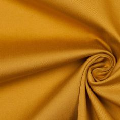 Looking for a medium-weight sateen? Then this fabric from the famous fashion label Theory may be the perfect choice for you! Here we have a medium-weight, cotton and elastane blended, gaze gold sateen with a great one directional stretch. This fabric has an soft and smooth hand, as well as a nice crisp drape. It can be used to create sassy trench coats, stylish pants, sophisticated shirts, lovely dresses, and more!