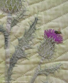 """Closeup photo, """"A Pasture Poem"""" by Aileyn Renli Ecob. Featured Artist, 2015 DVQ show. Photo by Quilt Inspiration.  The bee was made with Tsukineko inks."""