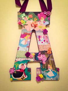 Any wooden letter decorated in Disneys classic movie:  **Alice in Wonderland**      This wooden letter is all about Disneys famous movie Alice in