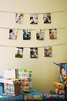 First birthday photo display --I just love the hanging photos.