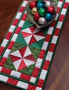 "This free ""Peppermint Candy"" table-runner pattern by Cheryl Almgren Taylor is chock-full of holiday cheer—use it to whip up Christmas table decorations in a snap for everyone on your gift list!"