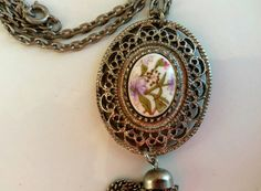 Check out this item in my Etsy shop https://www.etsy.com/listing/267108494/vintage-silver-tone-necklace-with-floral