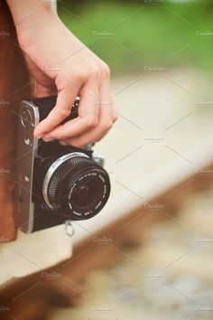 Check out Hand holding film camera by Nuchylee Photo on Creative Market Camera Art, Film Camera, Holding Hands, Hand Holding, Arts And Entertainment, Entertaining, Graphic Design, Creative, Olympus