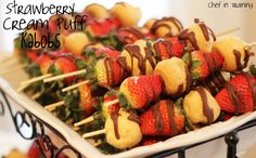 Strawberry Cream Puff Kabobs!  SO EASY to throw together and makes for a fun and yummy treat at a party, shower, or event!