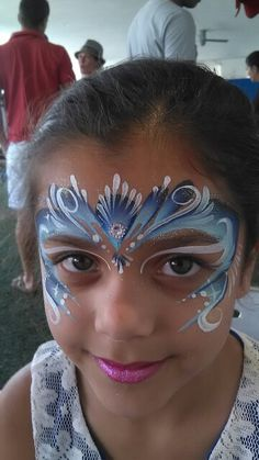 Face painting frozen one stroke split cake by Melinda Thompson Mindy Entertainment
