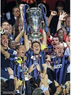 Diego Milito Champions League    Final hero gets his due reward at last.    After all his work with his teammates and sacrifices it to the top he succeeds.    I like the idea of a hero sacrificing for the greater good of the team finally getting credit for his work.   June 2010, Page 14