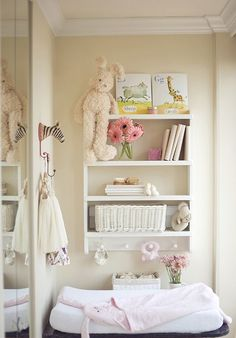 I like the shelves over the changing table for easy reach but I think it would need to be higher so baby can't grab things too!