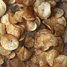 Crispy Rosemary Potato Chips | Prepared from scratch with paper-thin slices of russet potatoes and a sprinkling of fresh rosemary, crunchy sea salt, and crackled pepper, America's favorite snack food has never tasted better. | Country Living