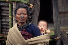 India | Apatani Woman with traditional facial tattoos and nose plugs | © Tiziana and Gianni Baldizzone/Corbis