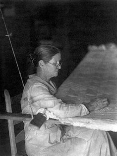 Women quilting.  This is almost a lost art, the hand quilted quilt.  Love this photo.