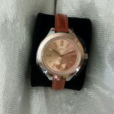 Ladies Watch This is a lovely watch with 8 diamonds as markers.  Swarovski  elements on outer dial.  Quartz movement.  Brown leather strap.  Never worn. JBW Jewelry