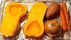 Roasted Butternut Squash Soup: 1 butternut squash (~3lbs), 1 soft sweet potato (often called yam in US), 1 medium onion, 2 carrots, 1 clove garlic, 1 can light coconut milk, pinch of whole cumin seeds, salt and pepper to taste  -  Makes 2 quarts soup.