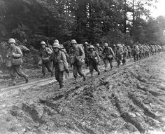 Japanese-American (Nisei) infantrymen of the Regimental Combat Team hike up a muddy French road in the Chambois Sector, France, in late (Army Center for Military History file photo) Gi Joe, Tuskegee Airmen, Japanese American, United States Army, American Soldiers, Photos Du, Ww2 Photos, Us Army, World War Two