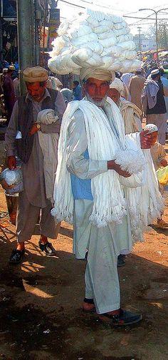 Vendor of Shalwar Fasteners (a form of belt),  Peshawar, Pakistan. Shalwar are loose pajama-like trousers.