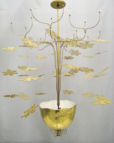 Custom-made ceiling lamp in brass for the Restaurant Kaupunginkellari, Helsinki, Finland 1947. Manufactured by Taito Oy. Image copyright by Helsingin Kaupunginmuseo.