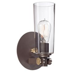 Cast a warm glow in your office or entryway with this industrial-style wall sconce, featuring a vintage-inspired bulb and glass hurricane shade.