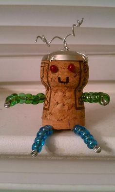 "my very own creation! I call him ""Corkbot"". It's a clever way to make an ornament and recycle corks at the same time."