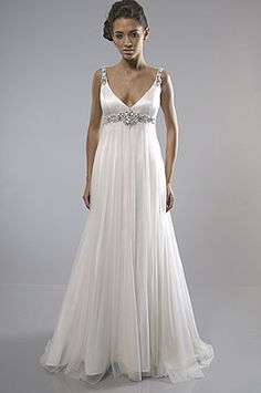 2000s Empire inspired wedding dress. This dress has the empire waistline which is classified as being a fitted bodice just below the bust and long, loose fitting skirt.