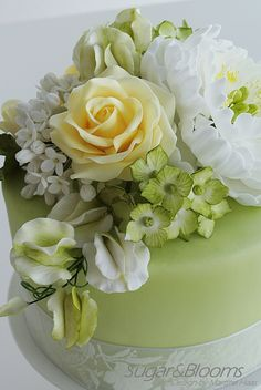 Sugar flower cake in soft green and yellow shades - peonies, roses, sweet peas and hydrangeas out of gumpaste, sugarpaste