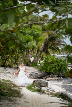 Anna and Spencer Photography, Atlanta Documentary Wedding Photographers. Bride walking on the beach to see her groom for the first time before their wedding on Ambergris Caye, Belize. Bride and groom's first look.