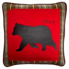 Cotton and linen pillow with a black bear silhouette and plaid border. Product: Pillow Construction Material: ...