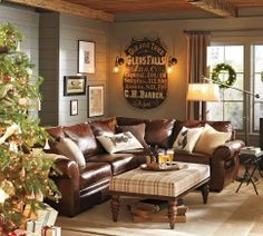 Pottery Barn: wall color, leather couch/sofa, floor arm lamp, graphic wall sign