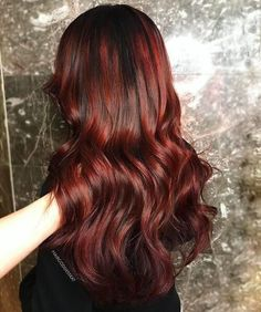 Dark red hair with black roots