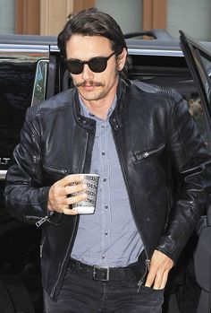 James Franco adds round shades to his leather jacket and black jeans for an edgy outfit.