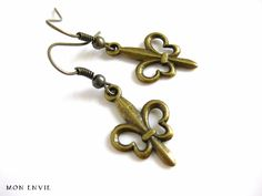 Antiqued Brass Fleurdelis Dangle Earrings. $5.00, via Etsy.