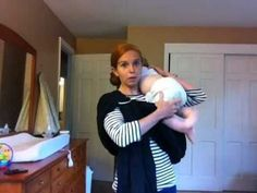 Great video on how to use a ring sling! Plus she has more baby wearing videos.