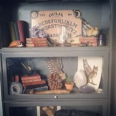 Cabinet of curiosities ****What's really weird is that I have that exact cabinet in a different color, and the same Ouija board.****