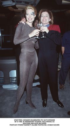 "Star Trek Voyager - Jeri Ryan (Seven of Nine) and Kate Mulgrew (Capt. Kathryn Janeway) toast Star Trek Voyager's 100th episode, ""Timeless"" in 1998."