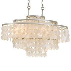 The Brielle Collection is an organic mix of glamour and elegance. Antique Silver metal offset organic, textured Capiz shells to form the luminous elegance of this six-light linear chandelier.