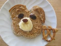 """Teddy Bear Sandwich - So easy! Your peanut butter lid is a perfect size to cut the round bear head and to """"glue"""" on ears from bread scraps. Raisins and a banana slice complete his bear face. Awesome!  GiantTeddy.com  Who wants to go on a teddy bear picnic?"""