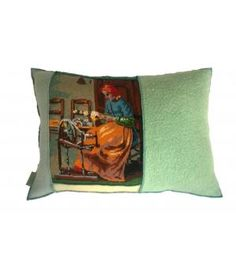 Groot woonkussen van wollen dekens en een oud borduurwerk. De  afmeting van dit kussen is 50-70 cm. Inclusief nieuw veren binnenkussen.
