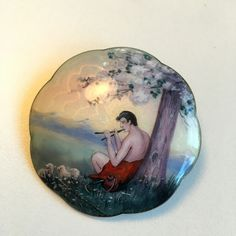 Gustav Gaudernack workshop. Silver guilloché enamel brooch with enamel painting of pastoral landscape with flute playing shepherd.