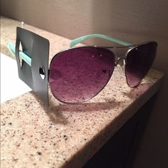 Aviator Sunglasses NWT New with tags Aviator sunglasses with beautiful aqua arms. Other