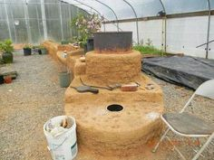 Mass heater - an inexpensive way to heat the greenhouse in cold winter months