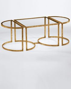 This gold trim glass top coffee table is slightly out of my price range, but pretty.