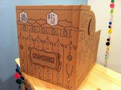 better image of the awesome handmade cash register. And a great article on how to prepare for a craft fair.