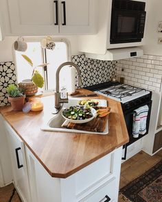 Their compact kitchen includes wooden worktops a hob, oven and even a microwave. Their compact kitchen includes wooden worktops a hob, oven and even a microwave. Camper Life, Rv Campers, Camper Trailers, Rv Bus, Bus Life, Van Living, Tiny House Living, Living Room, Remodel Caravane